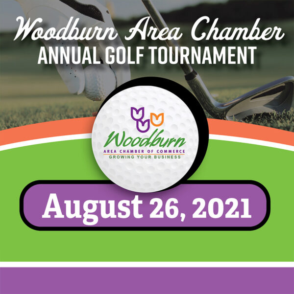 golf ball with Woodburn Chamber of Commerce logo on it, August 26, 2021, annual golf tournament with colorful background and golf picture